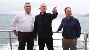 Happier times. Prime Minister Malcolm Turnbull with local member Ewen Jones and minister Greg Hunt near Townsville during the campaign.