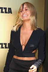 Lara Bingle arrives on Victoria Derby Day at Flemington Racecourse.