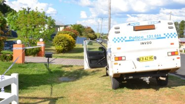 Police outside Simone Mottram's home in Froude Street, Inverell, where her son is accused of stabbing her to death.