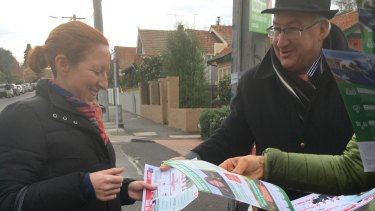 Labor MP for Melbourne Ports Michael Danby hands out his how to vote cards.