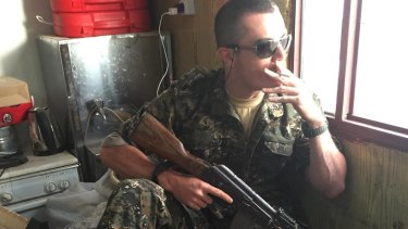 Brisbane man Ashley Dyball, aka Mitchell Scott, is fighting against Islamic State.