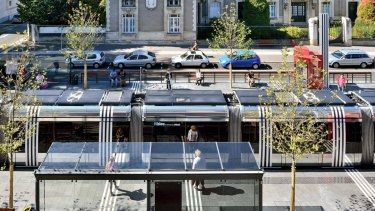 A light rail station in the city of Tours, France, with white and black motifs.