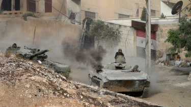 Syrian troops fighting rebels in the front-line Harasta district, which lies on the north-eastern edge of Damascus.