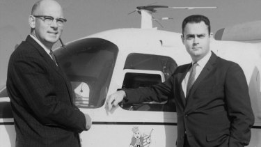David Edgerton, right, with his Burger King partner, James W. McLamore, in the 1960s beside a company plane.