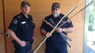 Acting Superintendent Steve Hayworth and Acting Senior Sergeant Owen Blackwell with a small number of the weapons confiscated following the fatal brawl.