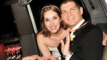 Neely and Andrew Moldovan, shown on their wedding day, may have to pay their photographer $US1 million after a dispute made international news.