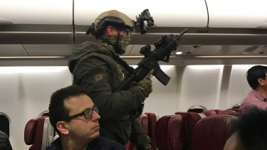 Heavily armed police storm a Malaysian Airlines flight in Melbourne in June after waiting 90 minutes.