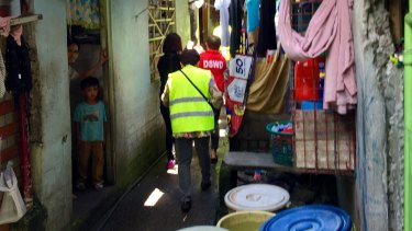 Police conduct a raid in Bacolod City, the capital of Negros Occidental, an impoverished Philippine province.