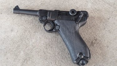 A decommissioned Lugar pistol seized off Michael James Holt.