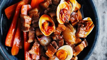 Slow-braised pork with carrots, eggs and red shallots.