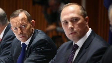 The then prime minister with Immigration Minister Peter Dutton.