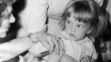 A little girl receives a polio vaccine at Broadmeadows Town Hall in 1968.