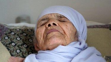 106-year old Afghan refugee Bibihal Uzbeki lies in bed in Hova, Sweden.