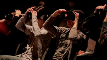 Audience members wearing VR headsets for playwright Jack Lowe's <i>Frogman</i>.