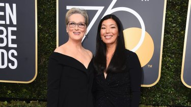 Meryl Streep, left, and Ai-jen Poo arrive at the 75th annual Golden Globe Awards at the Beverly Hilton Hotel on Sunday, Jan. 7, 2018, in Beverly Hills, California.
