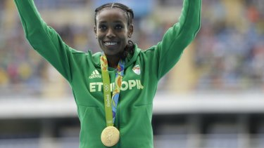Smashed the world record: Ethiopia's Almaz Ayana celebrates winning the gold medal.