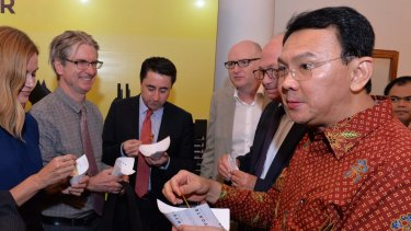 Australian journalists and the country's ambassador to Indonesia, Paul Grigson (right, in beige jacket), with Jakarta governor Basuki Tjahaja Purnama (right), known by his nickname, Ahok, at Jakarta city hall in March.