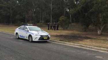 Police are searching an area in Sydney's south west after finding the burnt out car used in a fatal shooting this week.