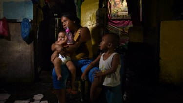Seven month pregnant Ruth-Jane Sombrio with her children. Her husband, a drug user, was shot dead in front of her, a casualty of President Duterte's deadly campaign.