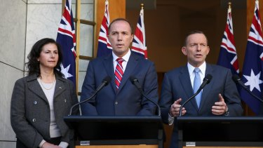 Senator Concetta Fierravanti-Wells, pictured with Immigration Minister Peter Dutton, and former prime minister Tony Abbott, has distanced herself from the rhetoric of Mr Abbott.