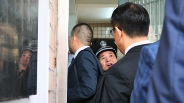 Lawyers for the accused were forced to wait for the small security door to the court and detention complex to be opened.
