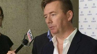 President of the Australian Medical Association, Brian Owler, addresses the media on Sunday.