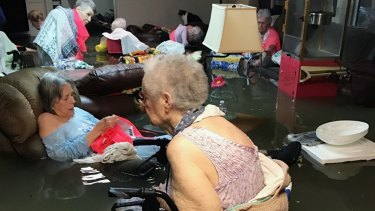 The viral image: residents of the La Vita Bella nursing home in Dickinson, Texas, sit in waist-deep flood waters caused by Hurricane Harvey.
