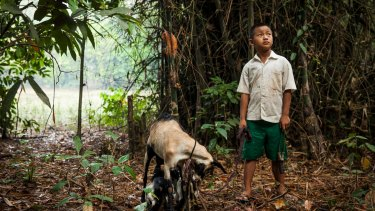 Saw Ba Sun, 9, was injured by an unexploded landmine two years ago in Ann Ka Law village, Kyin State.