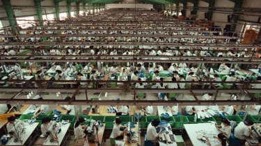 A Vietnamese sweatshop for Nike brand trainers, photographed in 1997. Conditions have improved in some but not all south east Asian garment factories.