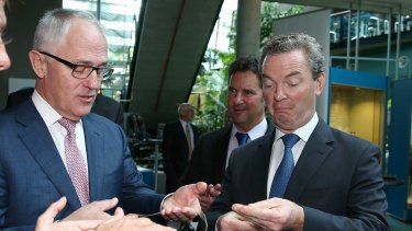 Prime Minister Malcolm Turnbull and Minister for Industry, Innovation and Science Christopher Pyne look at samples of bee silk ahead of their announcement of the national innovation and science agenda at the CSIRO Discovery Centre in Canberra.