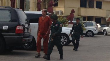 Australian James Ricketson is escorted into a Phnom Penh court on Wednesday.