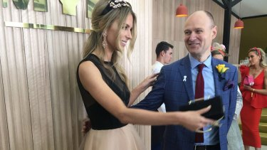 Partying as the enemy arrived: Myer CEO Richard Umbers with Jennifer Hawkins on Cup Day.