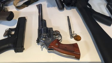 Two handguns and a pen pistol included in the police haul.