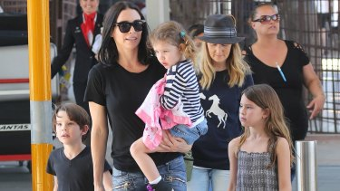 Erica Packer with children Jackson, Indigo and Emmanuelle, who have not been seen near their father during his recent excursions with Carey.