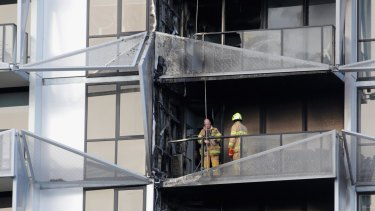 Firefighters at the scene of the Lacrosse building fire last November.