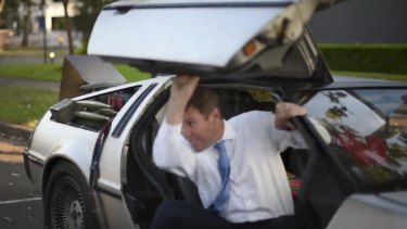 Stunt man ... Baird steps out of the DeLorean this morning.