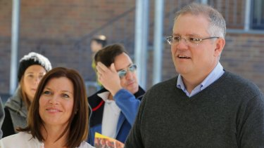 Treasurer Scott Morrison casts his vote with wife Jenny on Saturday.
