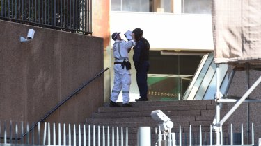 Officers from the bomb squad attend NSW Parliament House after reports of a suspicious package found near the building.