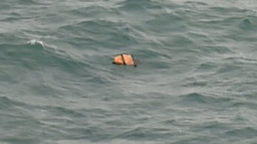 A photo taken from an Indonesian search and rescue aircraft over the Java Sea of debris from AirAsia flight QZ8501.