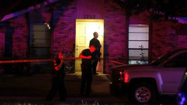 Police officers work the scene of a shooting at a home in Plano, north of Dallas, Texas.
