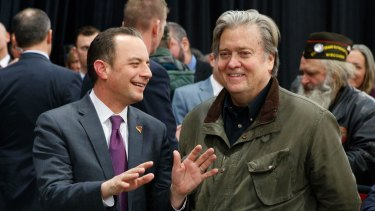 Trump's chief of staff Reince Priebus, left, talks with his chief strategist Steven Bannon last month.