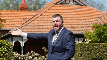 gent and auctioneer John Morrisby of Jellis Craig Real Estate in action at the weekend.