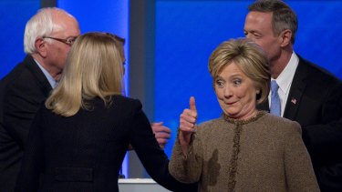 Hillary Clinton gives a thumbs-up after the Democratic presidential debate in Manchester, New Hampshire.