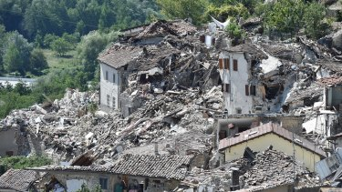Rubble surrounds damaged buildings on August 25 in Pescara del Tronto, Italy.