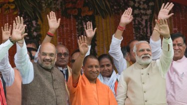 Yogi Adityanath, centre in saffron robes, with Indian Prime Minister Narendra Modi, second from right, after Adityanath's swearing-in in Lucknow on March 19.