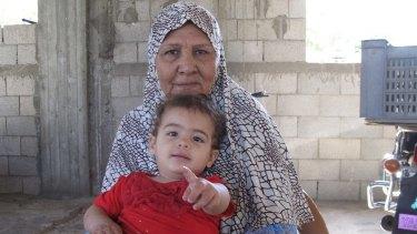 Dalal Siyam, 67, with baby Myar, 16 months.