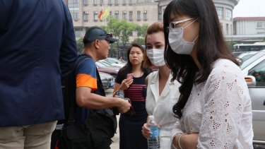 Employees and families of Crown Resort arrive at Baoshan People's Court on Monday morning.