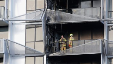 Firefighters at the scene of the Lacrosse building.