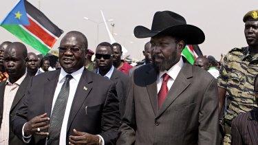 South Sudanese President Salva Kiir, centre-right, and then vice-president Riek Machar, centre-left in 2011.
