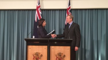 Greyhound commission of inquiry chairman Alan McSporran, QC, delivers his report to Premier Annastacia Palaszczuk.